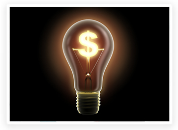 A brightly lit light bulb with a dollar sign as the filament