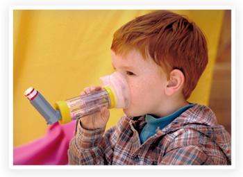 A child uses an asthma inhaler