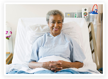 Smiling senior woman sitting up in a hospital bed