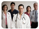 A group of five physicians standing together