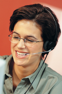 woman smiling with a phone head set on