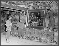 Soldiers viewing recovered looted artwork.