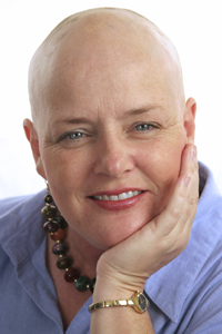 woman without hair smiling