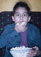 Boy having popcorn.