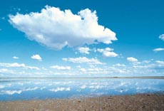 A blue sky with fluffy clouds