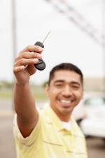 Teenage boy holding a car key