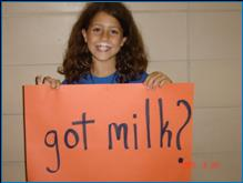 """Image of girl holding a sign that says, """"Got Milk?"""""""