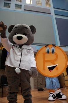 Dr. Bear ® and T.Markey, the USPTO's trademark mascot, at 2011 visit to Children's National Medical Center.  Photo by Roberto Ortiz.