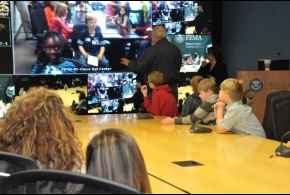 Administrator Craig Fugate answers questions from children via video-teleconference for Bring Your Kids to Work Day