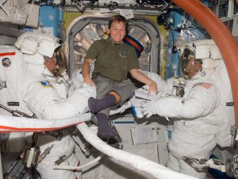 Pictured here on Oct. 28, 2007, Whitson, takes a moment to pose for a photo with astronauts Scott Parazynski (left), STS-120 mission specialist, and Daniel Tani, Expedition 16 flight engineer, as they prepare for the mission's second session of extravehicular activity (EVA).