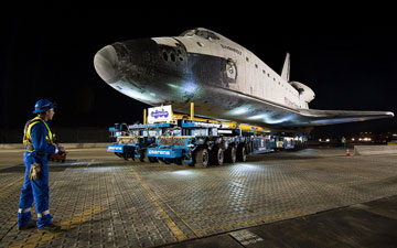 The driver of the Over Land Transporter is seen as he maneuvers the space shuttle Endeavour on the streets of Los Angeles as it heads to its new home at the California Science Center, Friday, Oct. 12, 2012.