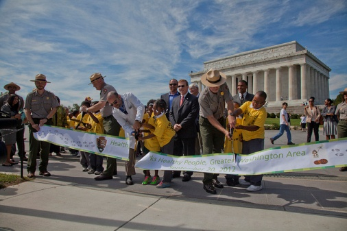 Third graders from Neval Thomas Elementary School help cut the ribbon for the DC Area first TRACK Trail on the National Mall.