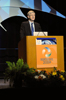 A photo of Dr. Francis Collins speaking at a podium.