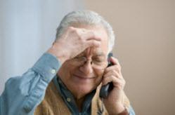 Senior talking on phone.
