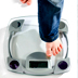 Photo of a child's foot stepping onto a scale.