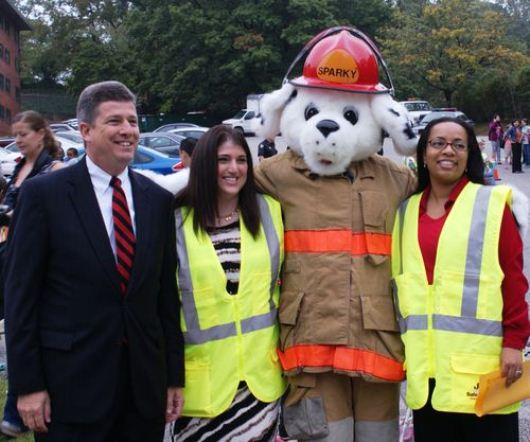Deputy Secretary Porcari with PBES Principal Rachel Dubois, Montgomery County Fire Department's Sparky, and Assistant Principal Orinda Nelson