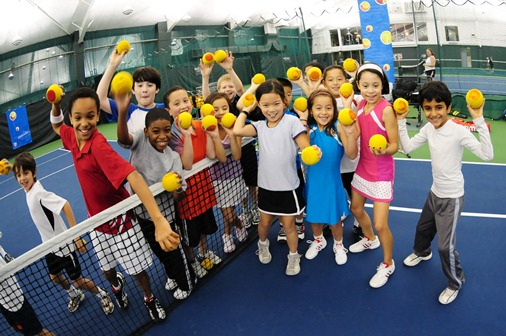 Kids playing with tennis balls
