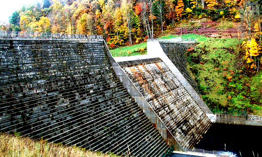 The Elkwater Fork Dam on the Tygart River in Randolph County, WVA is surrounded by fall foliage. USDA's Natural Resources Conservation Service provided assistance in the design and construction of the dam.