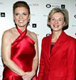 Sarah Ferguson, Duchess of York wearing a satin halter red dress poses with Elizabeth G. Nabel, M.D. who is wearing a red skirt suite backstage at The Heart Truth's 2005 Red Dress Collection Fashion Show.