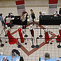 A birds-eye view of the 2008 Road Show set up, with mannequins wearing formal red dresses, and a crowd of people visiting the blood pressure stations set up on the periphery of the dress display