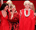 12 celebrity women in designer red dresses take a bow, blow kisses, wave and pose at the conclusion of The Heart Truth's Red Dress Collection Fashion show.
