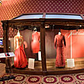3 First Ladies' red dresses in a display case