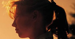 Side view of a young woman with a ponytail
