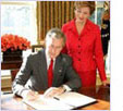 Image of Mrs. Laura Bush with then President George W. Bush at the 2005 proclamation signing.