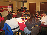 In Oklahoma City, Oklahoma, 13 women are sitting in a Champions training class.