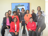 Eleven Champion women from Baton Rouge pose together.