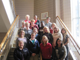 Sixteen men and women are photographed on a staircase in Madison, Wisconsin.