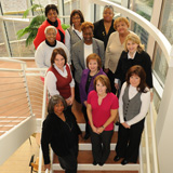 Twelve Cleveland Champions women stand on a staircase together.