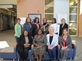 Ten women from the Wilmington Champions sit and stand together.