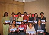 11 women are grouped together holding their speakers kit from the Jackson, Mississippi Champions training class.