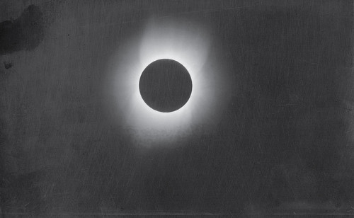 Image description: This photograph of the corona of the sun was taken during a solar eclipse in 1900 by Smithsonian photographer Thomas Smillie. A team from the Smithsonian Astrophysical Observatory loaded several railroad cars with scientific equipment and headed to Wadesboro, North Carolina. Scientists had determined that this small town would be the best location in North America for viewing an expected total solar eclipse, and the expedition hoped to capture photographic proof of the sun's corona. Smillie rigged cameras to seven telescopes and successfully made eight glass-plate negatives. At the time, Smillie's work was considered an amazing photographic and scientific achievement. Image courtesy of the Smithsonian Institution Archives