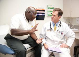 Dr. Carson talks with patient Lyle Bryant