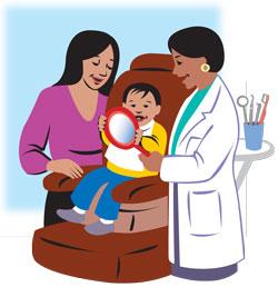 dentist checking a child's teeth