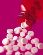 Fotografía píldoras que caen de un frasco