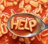 Alphabet soup letters spell HELP