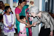 HHS Secretary Sebelius greeting a child in Belgaum, India.