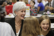 HHS Secretary Sebelius eats with children at Lowry Elementary School during an Education Drives America event in Denver, Colorado. Photo Credit: Mark T. Osler.