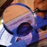 Magnifying glass over identification documents.