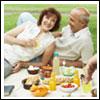 Senior couple enjoying picnic