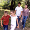 A family walking in a forest