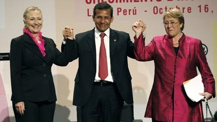 Date: 10/16/2012 Description: U.S. Secretary of State Hillary Rodham Clinton, left, Peru's President Ollanta Humala, center, and Michelle Bachelet, Chile's former president and U.N. women executive director, pose for photos at the opening of a conference on women's empowerment in Lima, Peru, Tuesday, Oct. 16, 2012.  © AP Image