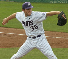 A baseball pitcher throwing a pitch
