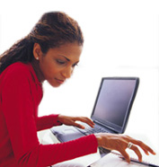 An image of a woman working at a computer