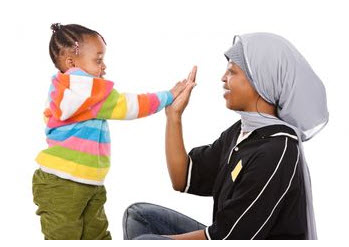 Photo: Adult and child playing high five