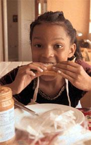 Photo of girl eating sandwich