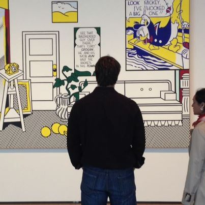 """Photo: Visitors enjoy Roy Lichtenstein's """"Artist's Studio 'Look Mickey'"""" (1973) on view in the exhibition which opens today! Sunday hours: 11 a.m. to 6 p.m."""